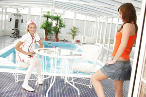 Lusty infant in nurse cosplay outfit has some girl-on-girl joy with her joyous friend