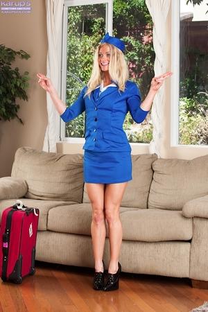 Teen queen with wild legs Bella Bends is posing in a blue uniform