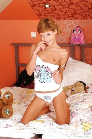 Ravishing youthful cutie takes off her panties to disclose her juicy pink gap