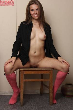 Amateur with diet shape Kira is sitting on the chair with amplify legs