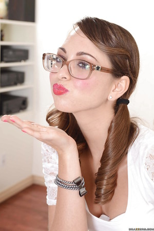 Brunette hair 19 girl in glasses Riley Reid slipping off her garments