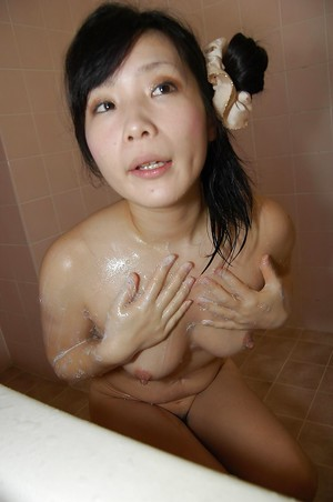 Smiley asian infant with intense tit buttons fascinating bathroom and caressing she is