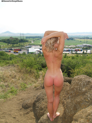 Playful fairy with nicce meatballs stripped off down and gets wet outdoor