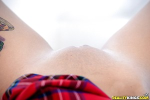 Teen schoolgirl Kelly Greene flashing smooth upskirt pussy