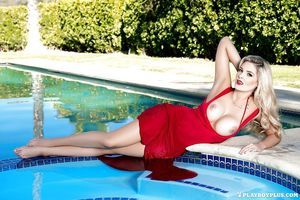 Elegant golden-haired vixen Sarah Louise Harris gets comfortable at a pool