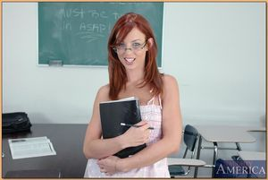 Redheaded coed lass in glasses Riley Shy showing off her stunning holes