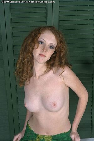 Youthful redhead Dawn shows off in her stunning green strings in close up