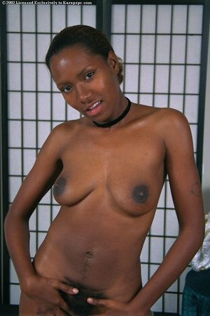 Amateur African hottie Dazy plays with her all-natural boobies