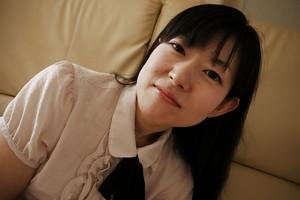 Japanese Milf lass Ayane Ikeuchi posing in schoolgirl uniform and pantyhose