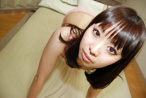 Asian teen Misato Uemoto undressing and exposing her wet unshaved cage of love