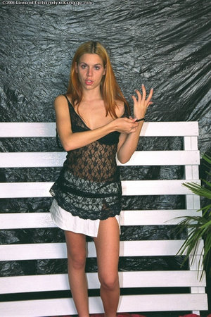 Blonde slut with weighty breasts undressing and showing her body