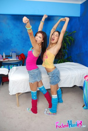 Petite young girls in knee socks erotic dancing and exposing their moist fannies