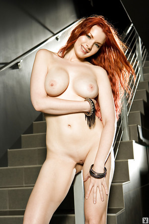 Boobsy redhead coed Kinsey Elizabeth slipping off her top and panties