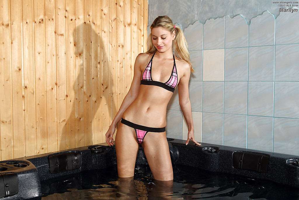 Blonde amateur Marilyn posing in bra and pigtails while in hot tub