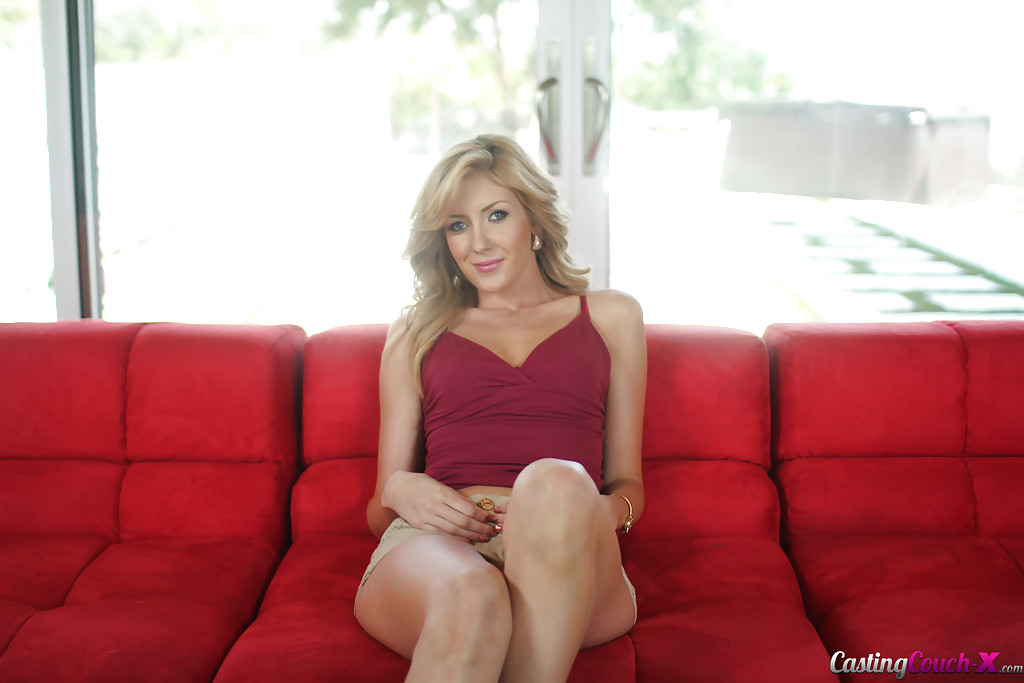 Masturbating action from an amateur babe Emily Kaye on her red couch