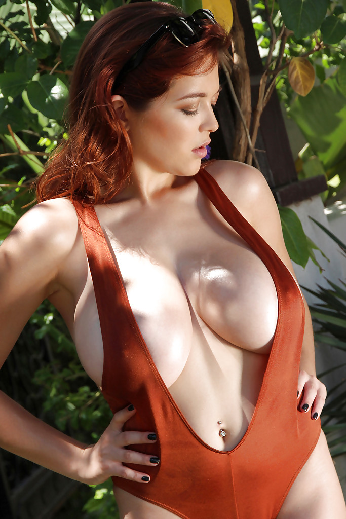 Big-tit redhead beauty Tessa Fowler shows off her amazing big tits