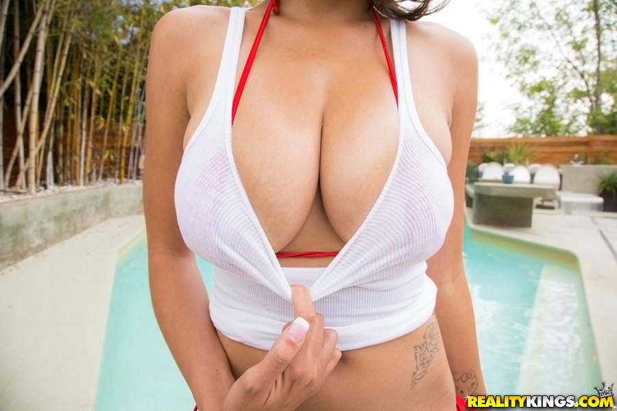 Latina Cassidy Banks pose at the poolside and plays with big boobies
