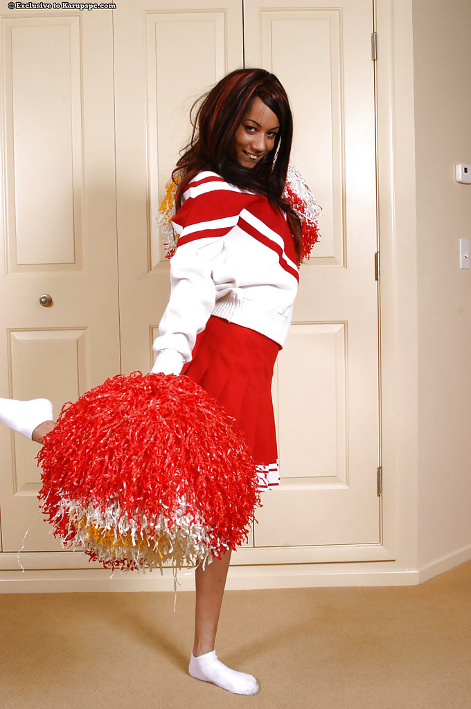 Amateur teen babe Mya Mason undresses her red cheerleader uniform