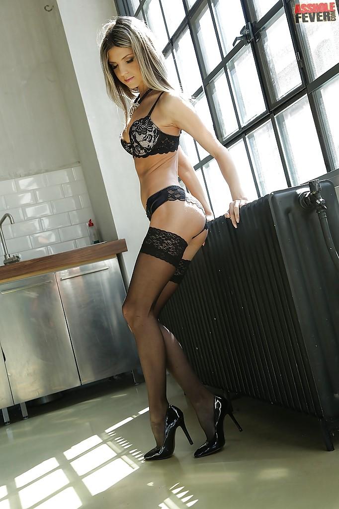 Beautiful Euro lingerie model Doris Ivy strutting in high heels