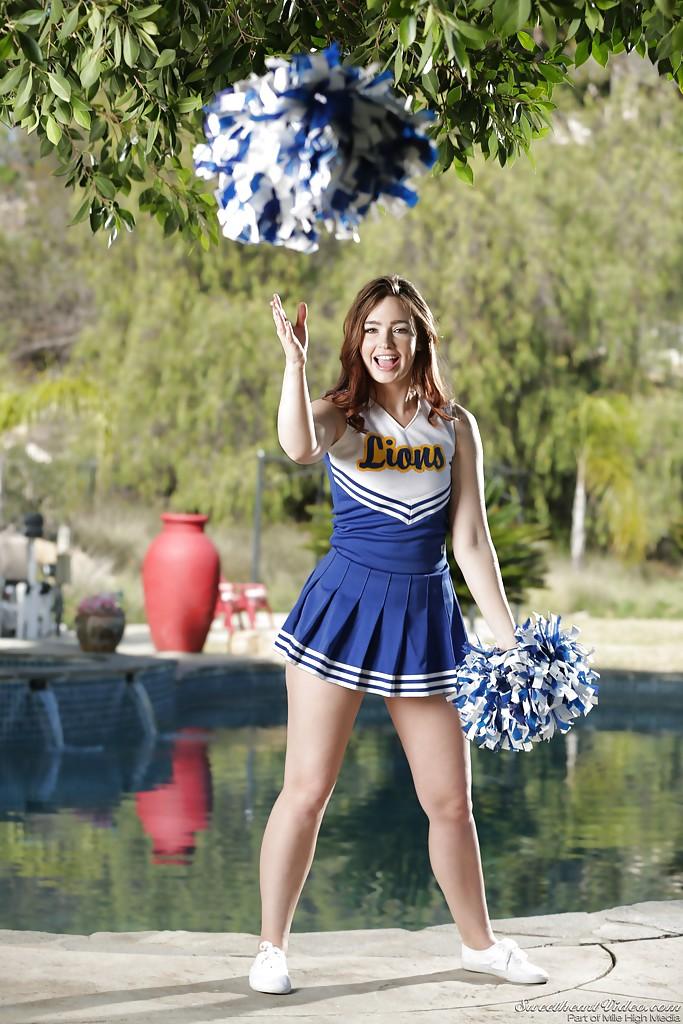 Solo babe Jodi Taylor shucking cheerleader uniform outdoors