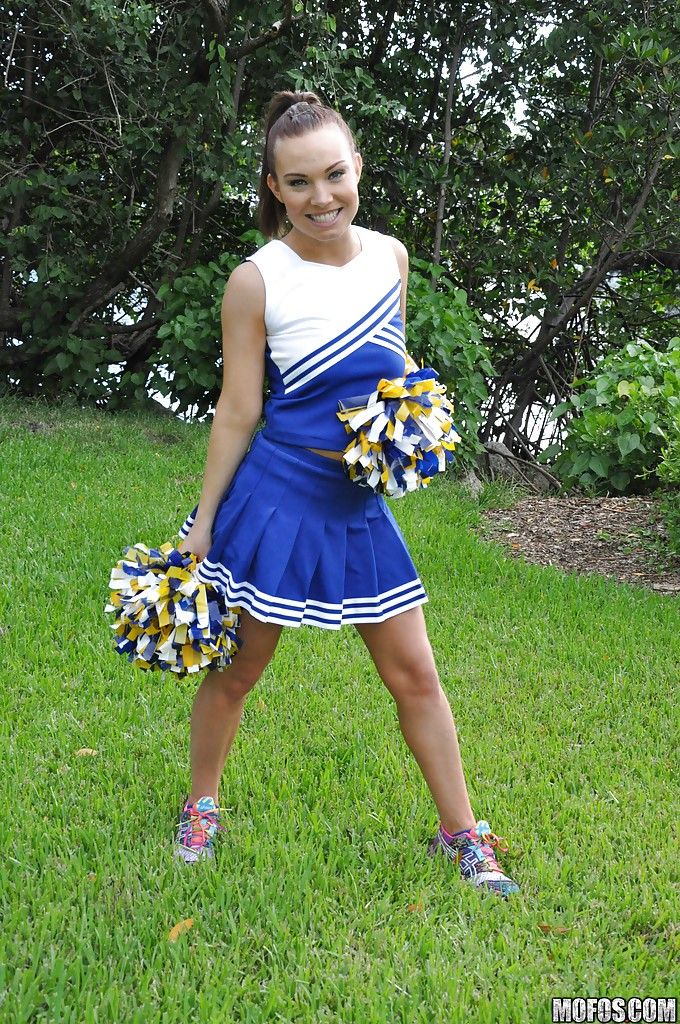Amateur cheerleader Tiff Bannister shows off in a sexy uniform