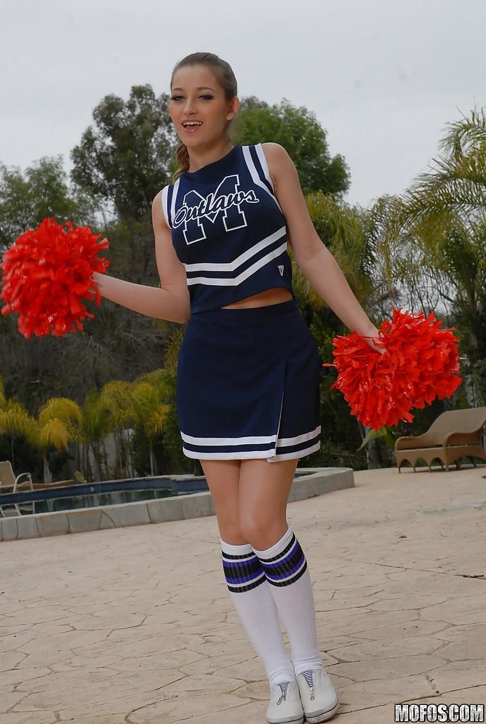 Teen cheerleader Dani Daniels pulls up her skirt to toy her gloryhole