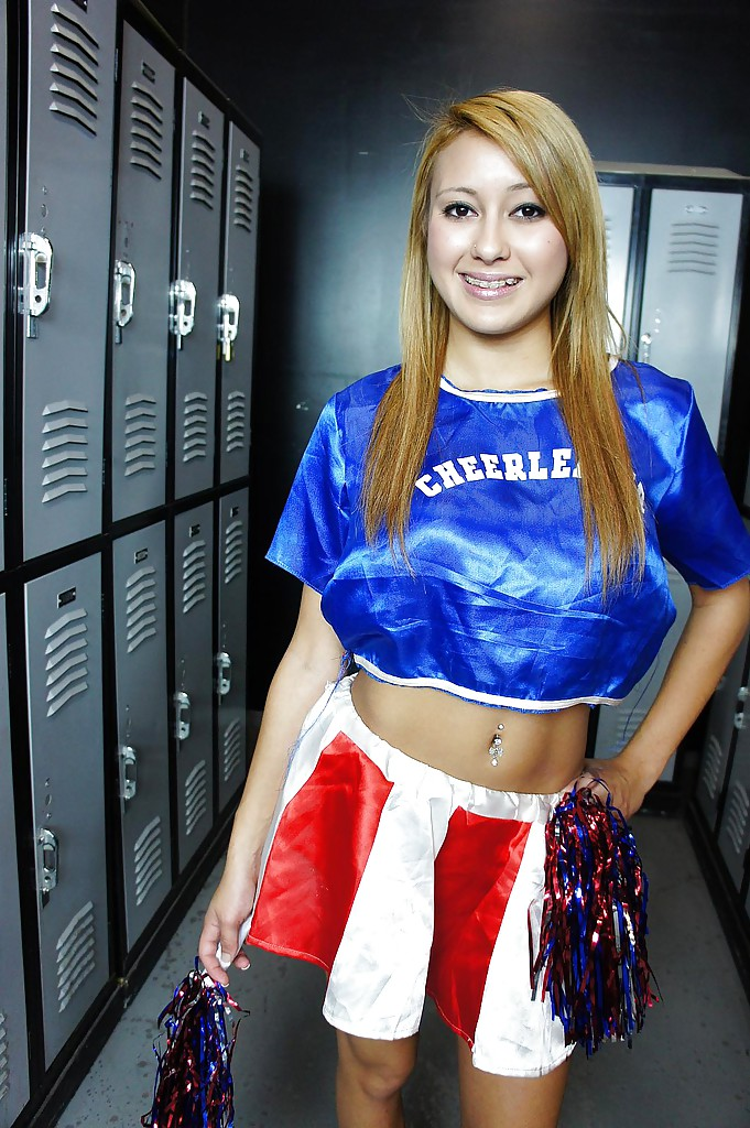 Big tit blonde cheerleader Marina is undressing her sexy uniform