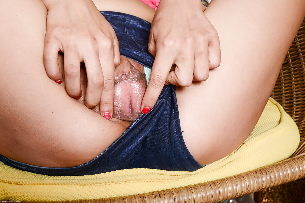 Adorable and beautiful Asian girl Miko spreading her holes
