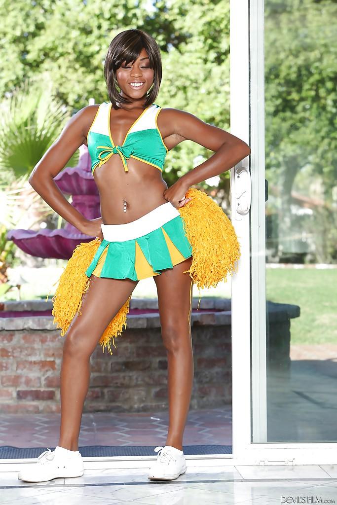 Black cheerleader Karma May shows off her big dark ass and tits