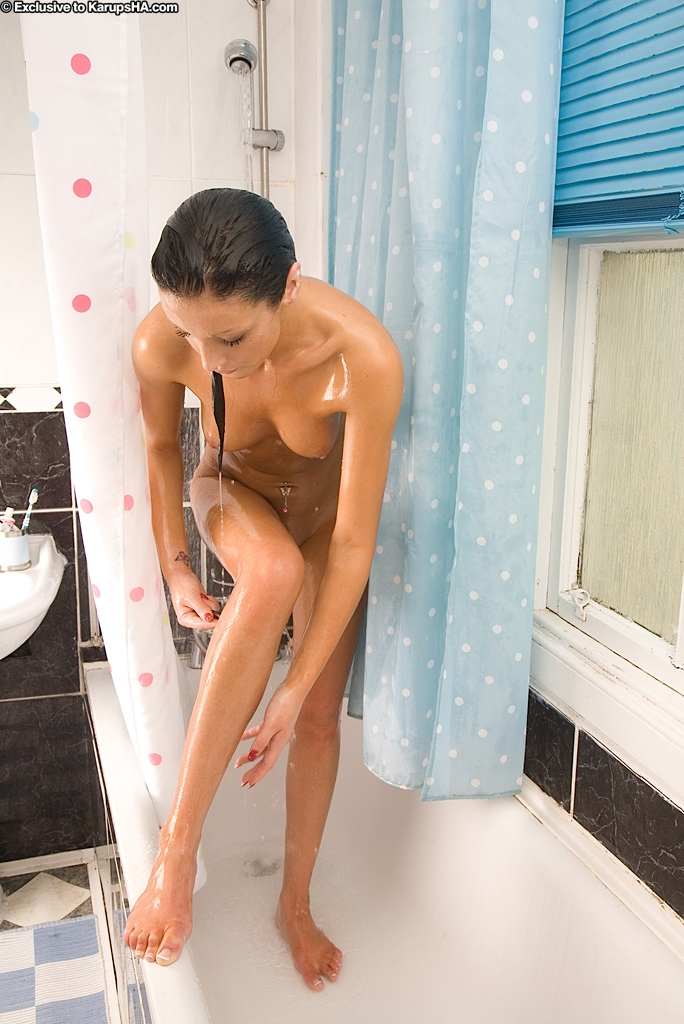 Brunette babe with a nice ass Jade is washing her tight pussy and body