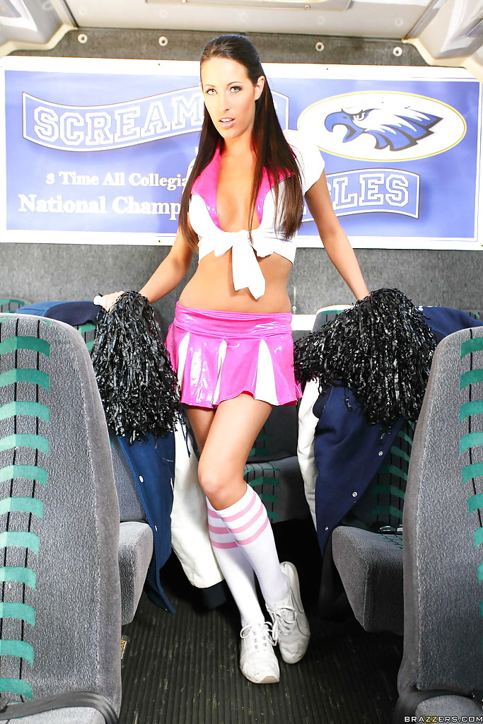 Lovely pornstar is posing as a cheerleader schoolgirl with big tits