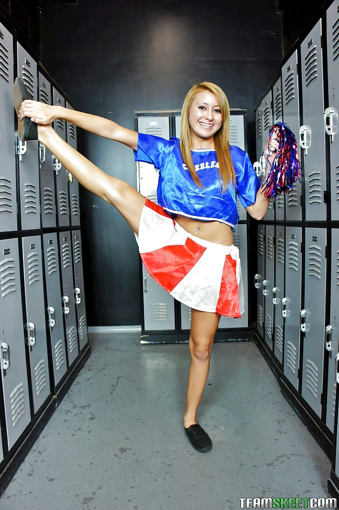 Latina schoolgirl Marina Angel poses in her sexy cheerleader suit
