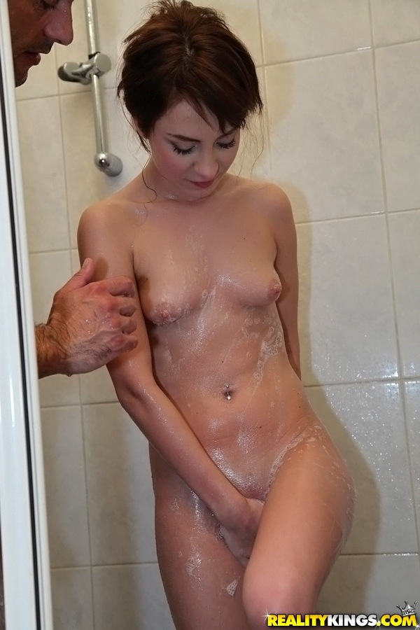 Naughhty amateur gets her soapy petite curves rubbed in the shower