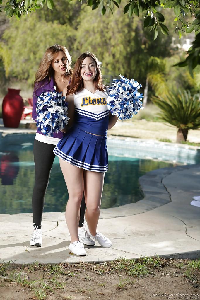 MILF Julia Ann and teen cheerleader Jodi Taylor have lesbian sex outdoors