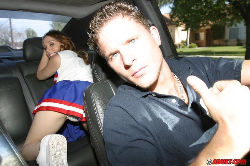 Frisky teenage cheerleader revealing her goods on the back seat