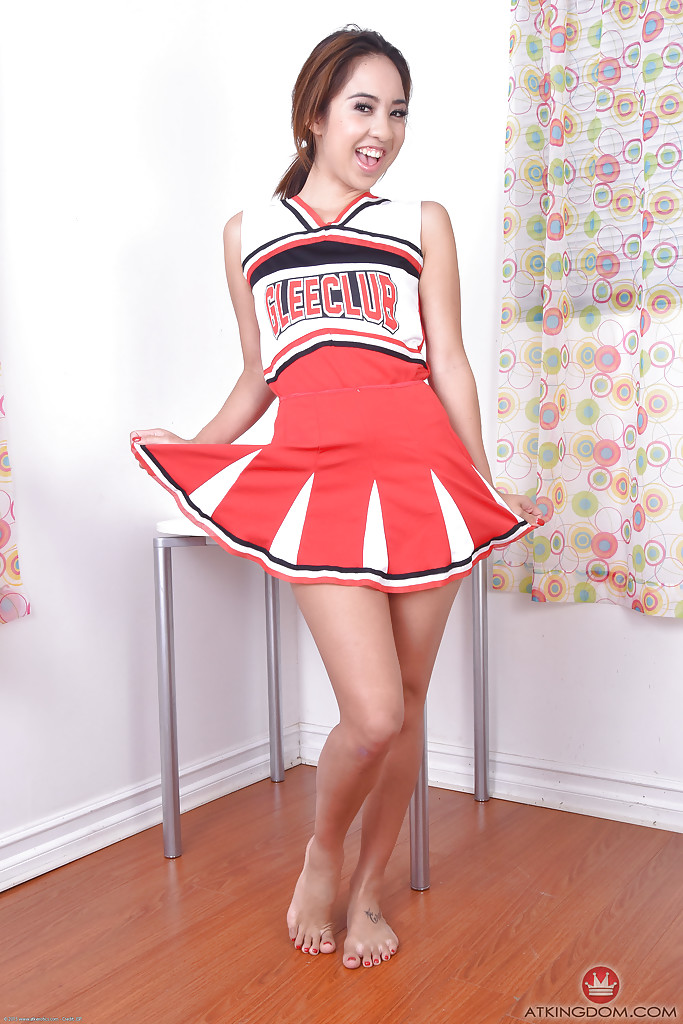 Young Asian amateur Mila Jade exposing tiny tits beneath cheerleader outfit