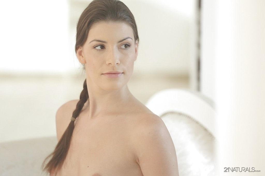 Pretty brunette babe with tiny tits undressing her shaved pussy