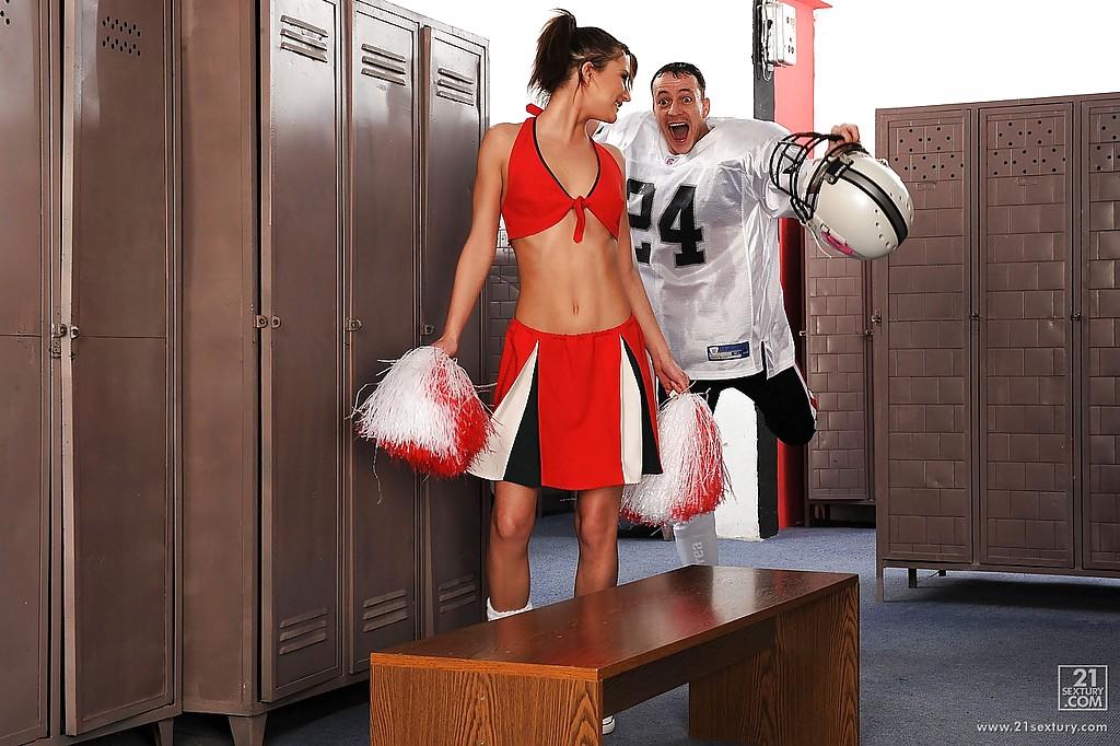 Sexy cheerleader Kim Kay turned into a cocksucker in the locker room