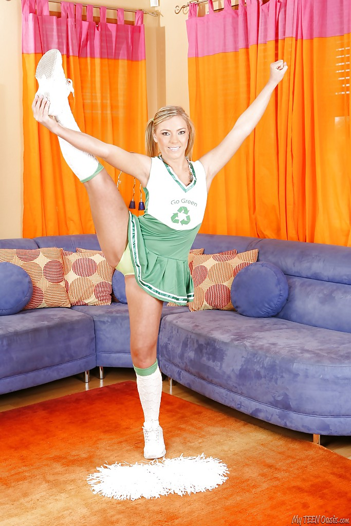 Fuckable blonde cheerleader in socks uncovering her flexy body