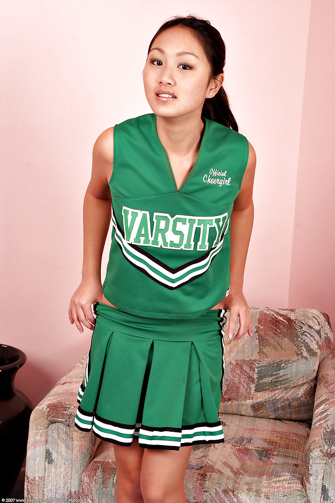 Asian amateur Evelyn Lin removes cheerleader uniform to expose tiny tits
