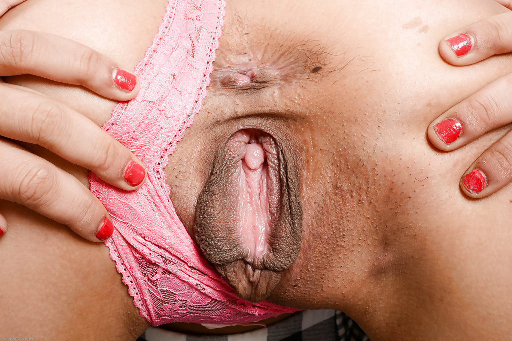 Asian babe Miko Dali teases her amateur shaved pussy in close up
