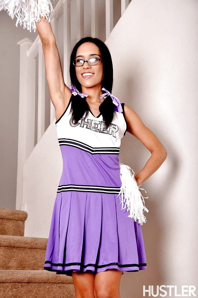 Tia Cyrus lifts up sexy cheerleader uniform to flash pretty panties