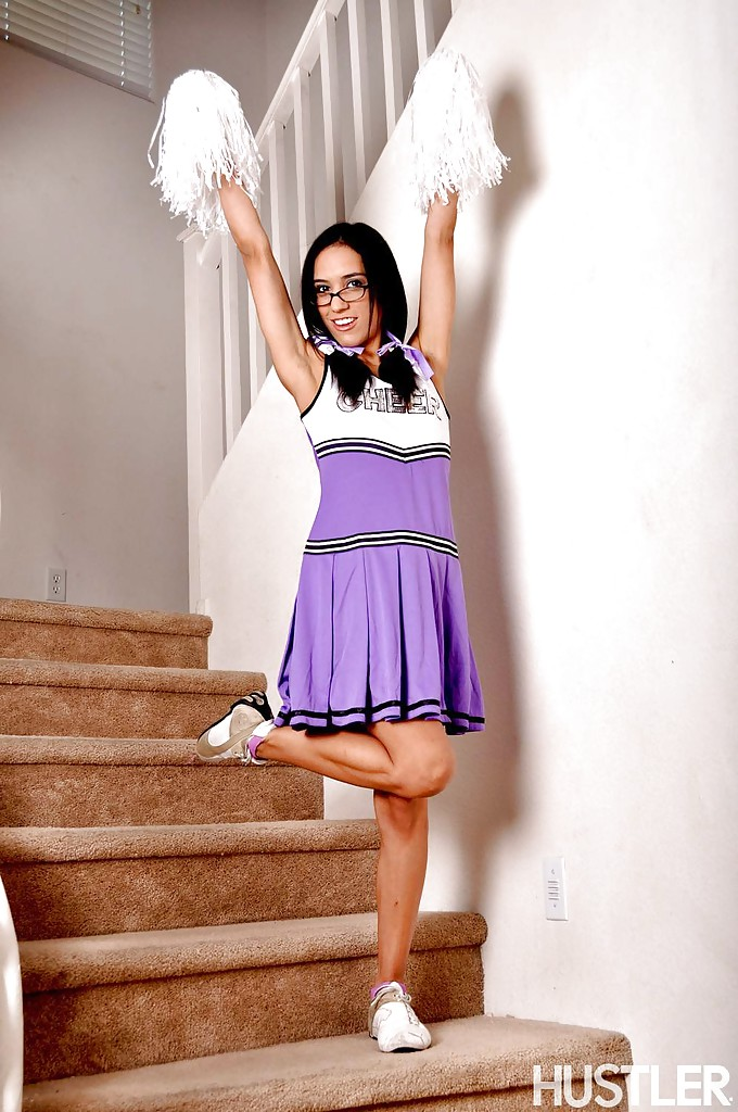 Tia Cyrus lifts up sexy cheerleader uniform to flash pretty panties