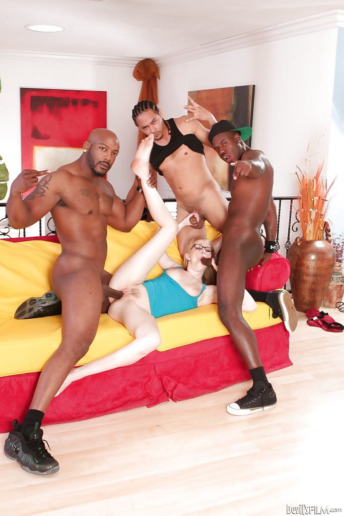 Three dudes with big black poles are cumming on the face of an angel