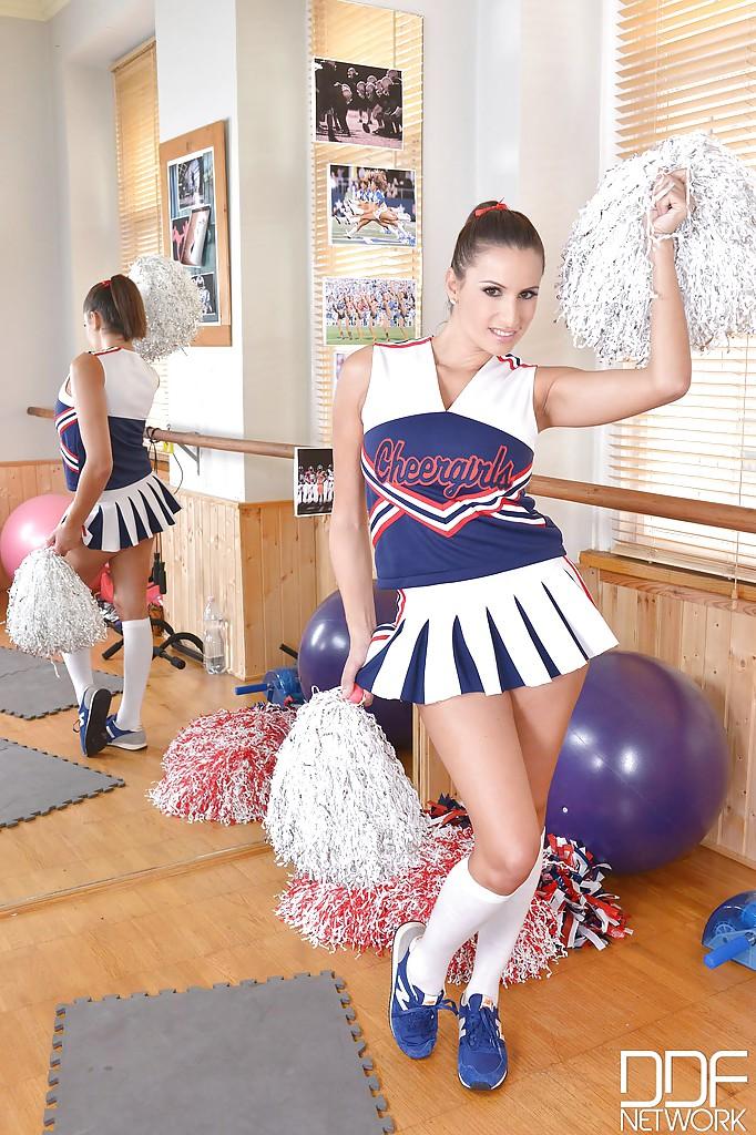Busty young cheerleader Sensual Jane flashing large natural knockers