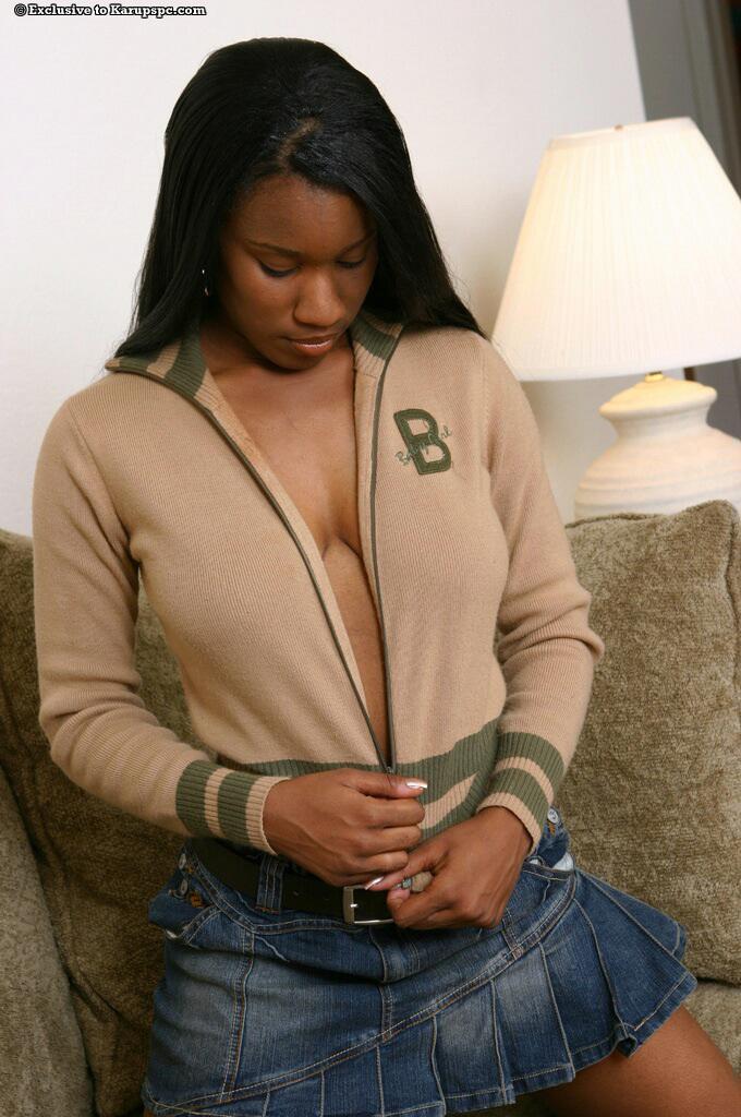 Ebony teen babe Krystal reveals her amateur pussy while teasing it