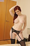 Steamy redhead vixen in ebon nylons slipping off her sexy pants