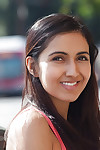 Terrific young teen hottie Vijaya Singh amplifying her legs outdoors