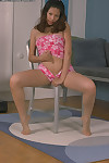 Marvelous model Niha is posing on her chair and playing with puss