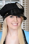Youthful doll Amanda Bryant posing in her wild police uniform